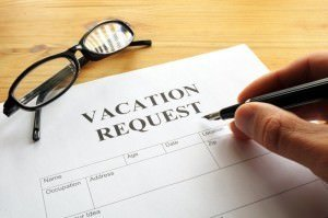 Someone filling out a vacation request form